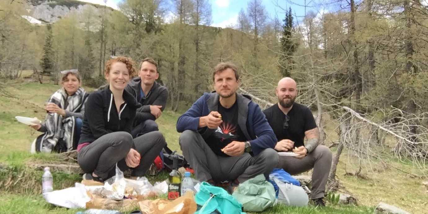 Friends having a picnic in the Slovenian Alps.